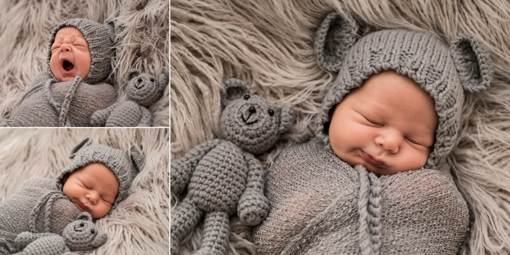 Newborn baby sleeps wrapped in gray swaddle